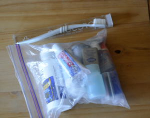 Plastic bag with liquids, razor, floss, and sense of adventure