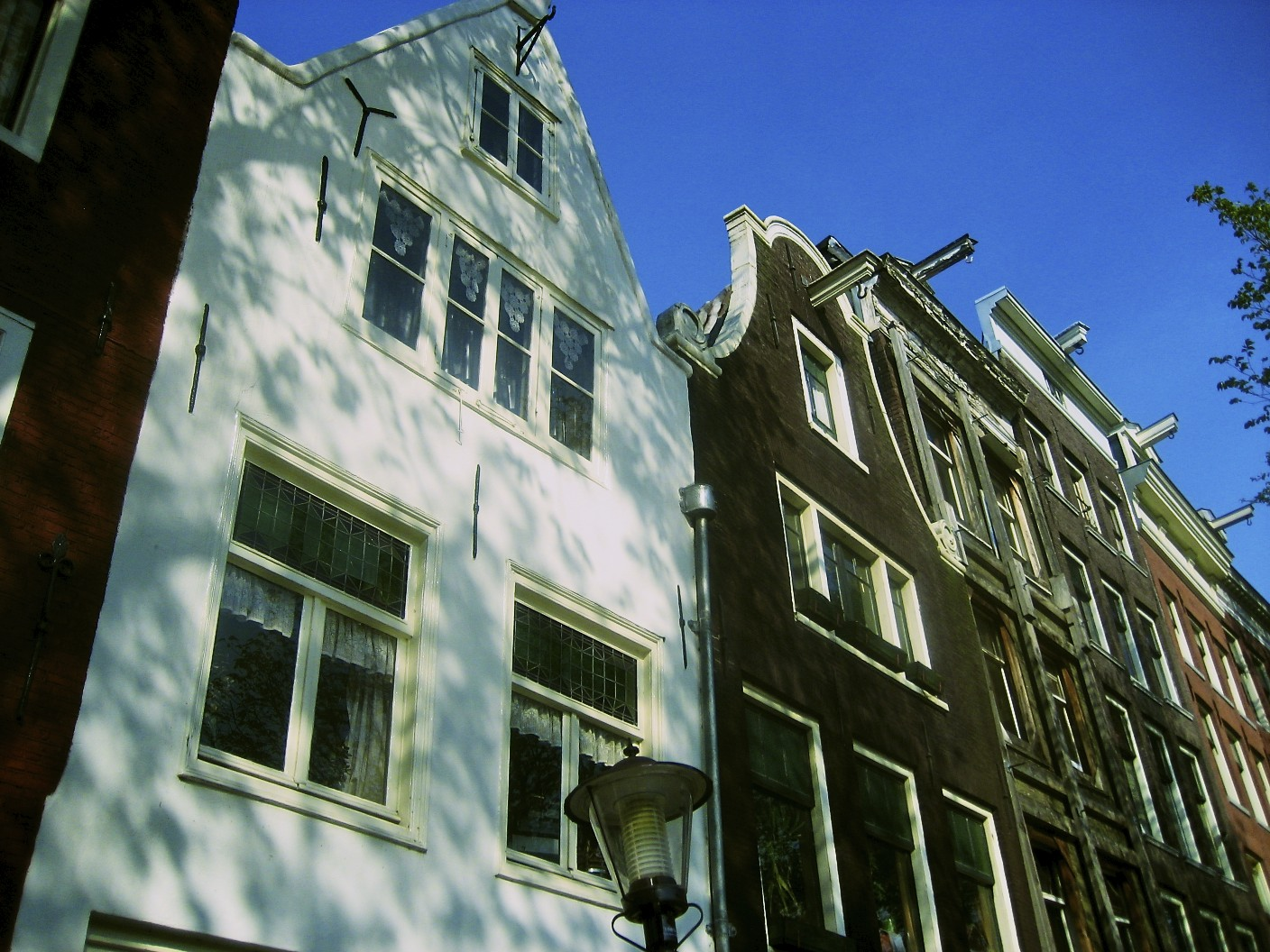 Amsterdam: houses loom over a canal